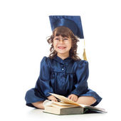 Funny kid in academician clothes with book — Photo