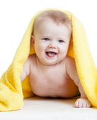 Adorable happy baby in towel — Stockfoto