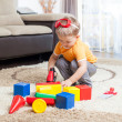 Child playing with building blocks at home.  — Stock Photo