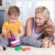 Cute mother and kid boy play together indoor — Stock Photo #35953033