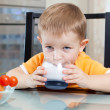 Foto Stock: Child drinking yogurt or kefir
