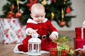 Christmas baby girl with lamp — Stock Photo