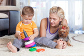 Cute mother and kid boy play together indoor — Stock Photo