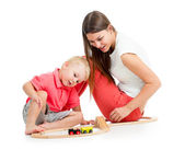 Kid boy and his mother play with block toy — Stock Photo