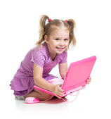 Funny child playing with laptop toy — Stock Photo