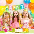 Happy kids celebrating birthday holiday — Stock Photo