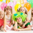 Jolly children and clown on birthday party — Stock Photo