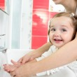 Kid washing hands in bathroom — Stock Photo #36779663