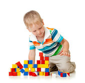 Kid boy playing wooden toys — Stockfoto