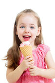Joyful child girl eating ice cream — Stock Photo