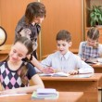 School children work at lesson — Stock Photo