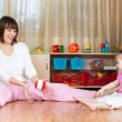 Mother and kid play with toy ball indoors — Stockfoto