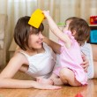 Mother and kid having fun pastime indoors — Stock Photo