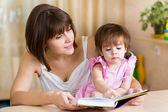 Mom and kid read a book — Stock Photo