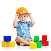 Child playing with building blocks toy — Stock Photo