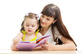 Mother reading a book to her kid — Stock Photo