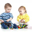 Children play with mosaic toy — Stock Photo #38000107