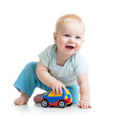 Smiling kid playing with toy — Stock Photo