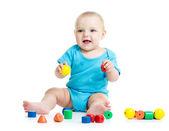 Baby boy playing toy blocks isolated on white background — Stock Photo