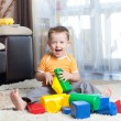 Child playing with building blocks at home. — Stock Photo #38637657