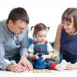 Stock Photo: Happy parents play with kid girl