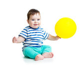 Smiling baby boy with ballon in his hand isolated on white — Stock fotografie