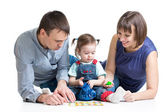 Happy parents play with kid girl — Stock Photo