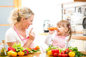 Mother and child preparing healthy food and having fun — Stock Photo
