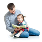 Father reading a book to kid — Stock Photo