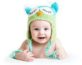 Baby in funny knitted hat owl on white background — Stock Photo