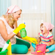 Mother with kid cleaning room and having fun — Stock Photo #39367517