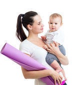 Mother going to do fitness exercises with her baby — Stock Photo