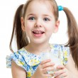 Stock Photo: Kid girl drinking yogurt or kefir over white