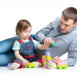 Stock Photo: Baby girl and father play toys together