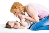 Joyful mother playing with her baby infant — Stock Photo