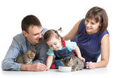 Kid girl and her parents feeding small kittens — Stock Photo