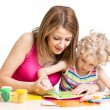 Stock Photo: Mother and kid painting together