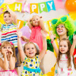 Jolly kids group and clown on birthday party — Stock Photo #39704329
