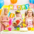 Boy with gift and group of kids at birthday party — Stock Photo