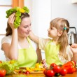 Stock Photo: Mother and kid cooking and having fun in kitchen