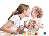 Mother and kid girl painting and having fun — Stock Photo