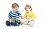 Kids play with mosaic toy — Stock Photo