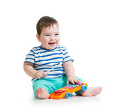 Baby playing with musical toys — Stock Photo