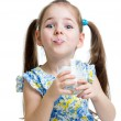 Stock Photo: Funny child girl drinking yogurt or kefir over white
