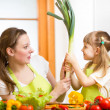 Mother and kid at kitchen — Stock Photo #39992809