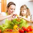 Mother and kid at kitchen — Stock Photo