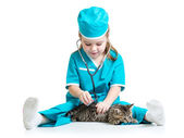 Child girl playing doctor with cat kitten — Stock Photo