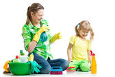 Mother with kid clean room having fun — Stock Photo