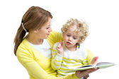 Mom reading a book to her kid — Stock Photo