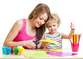 Mother and child paint and cut together — Stock Photo